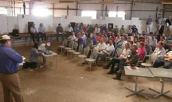 "Justin McClure addressing the crowd at the Lamb Production Workshop held in the woolshed on his Tilpa property ""Kallara"""